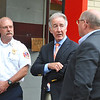 U.S. Congressman Richard Neal speaks with Noth Adasm Mayor Richard Alcombright, right, and Stephen Meranti, North Adams Fire Director. Friday, June 16, 2017. Scott Stafford  -- The Berkshire Eagle