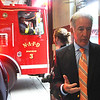 U.S. Congressman Richard Neal speaks with the press while a firetruck rolls out of North Adams Firehouse to repsond to a call. Friday, June 16, 2017. Scott Stafford  -- The Berkshire Eagle