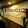 KRISTOPHER RADDER — BRATTLEBORO REFORMER<br /> Jodi Newell, of Keene, N.H., waits by a Tulsi 2020 sign during a town hall meeting at Willie Mac's Irish Pub and Restaurant, in Keene, N.H., on Saturday, Feb. 16, 2019.