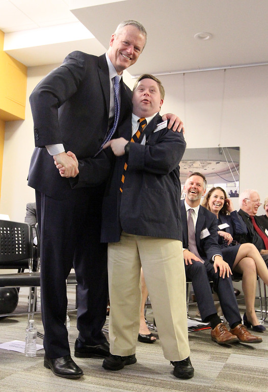 . Gov. Charlie Baker and Nancy Donahue\'s son Philip Donahue, at ribbon cutting and dedication of the Nancy L. and Richard K. Donahue UTEC Hub for Social Innovation. (SUN/Julia Malakie)