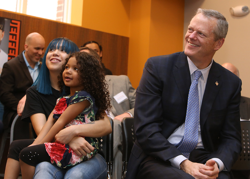 . Ribbon cutting and dedication of the Nancy L. and Richard K. Donahue UTEC Hub for Social Innovation. UTEC speaker Felicia Noev of Lowell with her daughter Jaeda Kanda, 4, and Gov. Charlie Baker. (SUN/Julia Malakie)