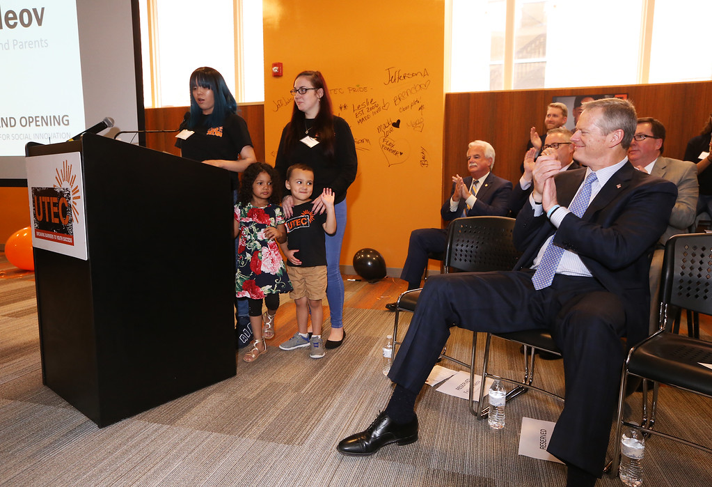 . Ribbon cutting and dedication of the Nancy L. and Richard K. Donahue UTEC Hub for Social Innovation. UTEC speakers Felicia Noev of Lowell with daughter Jaeda Kanda, 4, and Brenda Anderson of Lowell with son Isaiah Whitson, 4, and Gov. Charlie Baker. (SUN/Julia Malakie)