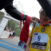 "Teodor Cariov, 9, of Boulder, gets his 3rd-Place medal put around his neck after finishing the Youth race on Thursday, June 9, during the Uni-Hill 2K run in the University Hill area of Boulder. For more photos and video of the race go to  <a href=""http://www.dailycamera.com"">http://www.dailycamera.com</a><br /> Jeremy Papasso/ Camera"