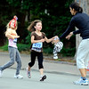 """Emma Perschke, 8, at left, and Sophie Spalding shed a layer of clothing and give it to Spalding's mother Laura during the family and friends division race on Thursday, June 9, during the Uni-Hill 2K run in the University Hill area of Boulder. For more photos and video of the race go to  <a href=""""http://www.dailycamera.com"""">http://www.dailycamera.com</a><br /> Jeremy Papasso/ Camera"""