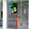 "A racer from the Masters 40+ division is reflected through a store window on Thursday, June 9, during the Uni-Hill 2K run in the University Hill area of Boulder. For more photos and video of the race go to  <a href=""http://www.dailycamera.com"">http://www.dailycamera.com</a><br /> Jeremy Papasso/ Camera"