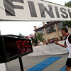 "A racer crosses the finish line in the Masters 40+ division race on Thursday, June 9, during the Uni-Hill 2K run in the University Hill area of Boulder. For more photos and video of the race go to  <a href=""http://www.dailycamera.com"">http://www.dailycamera.com</a><br /> Jeremy Papasso/ Camera"