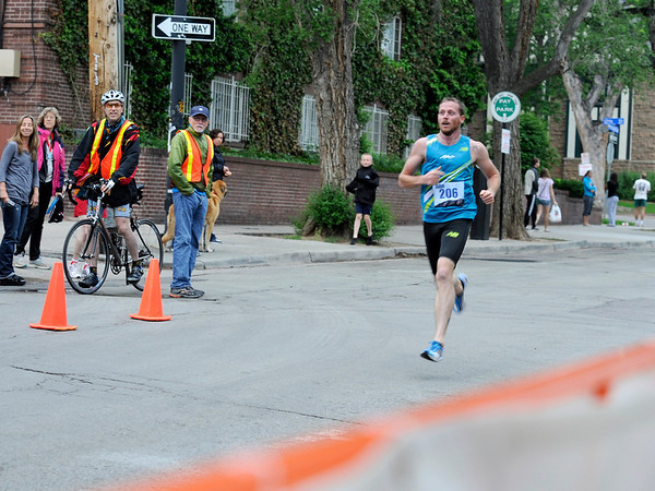 "James Hatch, 28, of Boulder, sprints towards the finish line while racing in the Mens Competitive division on Thursday, June 9, during the Uni-Hill 2K run in the University Hill area of Boulder. Hatch won the race. For more photos and video of the race go to  <a href=""http://www.dailycamera.com"">http://www.dailycamera.com</a><br /> Jeremy Papasso/ Camera"