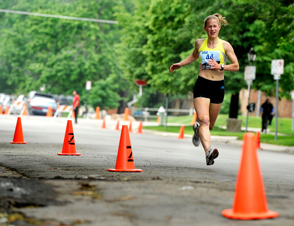 "Rachel Gioscia-Ryan, of Boulder, finishes the last leg of the female competitive division race on Thursday, June 9, during the Uni-Hill 2K run in the University Hill area of Boulder. Gioscia-Ryan won the race. For more photos and video of the race go to  <a href=""http://www.dailycamera.com"">http://www.dailycamera.com</a><br /> Jeremy Papasso/ Camera"