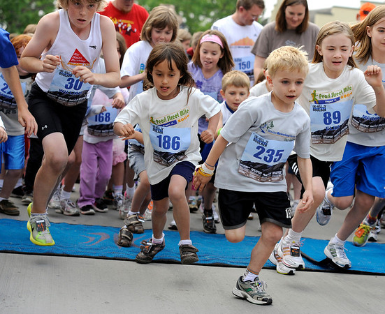 "Charlie Reish, 7, of Boulder, at front, and Olivia Roslansky, 6, of Boulder, left, sprint out of the start gate on Thursday, June 9, during the Uni-Hill 2K run in the University Hill area of Boulder. For more photos and video of the race go to  <a href=""http://www.dailycamera.com"">http://www.dailycamera.com</a><br /> Jeremy Papasso/ Camera"