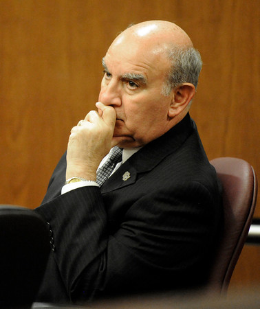 University of Colorado Chancellor Phil DiStefano listens to the words of Denver based attorney Robert Corry while he examines a witness during the hearing for the 4/20 closure of the Norlin Quad on the University of Colorado campus at the Boulder County Justice Center on Thursday, April 19, in Boulder.<br /> Jeremy Papasso/ Camera