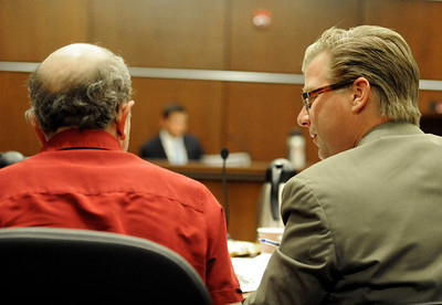 Denver based attorney Robert Corry, right, talks with witness Rob Smoke during the hearing for the 4/20 closure of the Norlin Quad on the University of Colorado campus at the Boulder County Justice Center on Thursday, April 19, in Boulder. Jeremy Papasso/ Camera