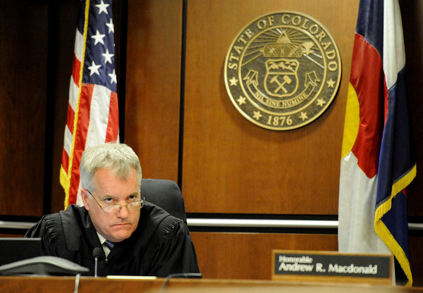 Boulder County Judge Andrew Macdonald listens to Denver based attorney Robert Corry examine a witness during the hearing for the 4/20 closure of the Norlin Quad on the University of Colorado campus at the Boulder County Justice Center on Thursday, April 19, in Boulder.<br /> Jeremy Papasso/ Camera
