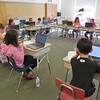 Paula Marinaro's fourth-grade students at Allendale Elementary School use laptops to conduct and organize independent research for an upcoming project on states in the U.S.