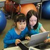 Students in Jessica Bazinet's first-grade classroom at Allendale Elementary School use laptops for independent learning and research.