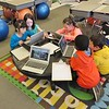 Students in Jessica Bazinet's classroom use laptops for cooperative and independent learning and research. Here, students are learning about the upcoming Earth Day.