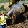 "Workers spray down a bucket as a backhoe removes lead contaminated soil as part of the Valmont Butte Remediation Project on Thursday May 10, 2012. <br /> Photo by Paul Aiken / The Boulder Daily Camera<br /> For a video of the project go to  <a href=""http://www.dailycamera.com"">http://www.dailycamera.com</a>"