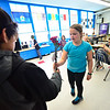 KRISTOPHER RADDER - BRATTLEBORO REFORMER<br /> Toby Peterson, sixth-grader at Academy School, helps hand out flowers to Kaylie Severance, a fourth-grader, for Valentine's Day on Wednesday, Feb. 14, 2018.