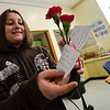 KRISTOPHER RADDER - BRATTLEBORO REFORMER<br /> Faith Copperthite, a fourth-grader at Academy School, looks at the flowers she received from an unknown sender for Valentine's Day on Wednesday, Feb. 14, 2018.