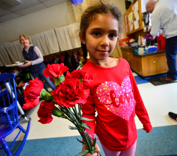 KRISTOPHER RADDER - BRATTLEBORO REFORMER<br /> Zanayah Persons, a kindergartner at Academy School, holds a handful of flowers she received for Valentine's Day on Wednesday, Feb. 14, 2018.