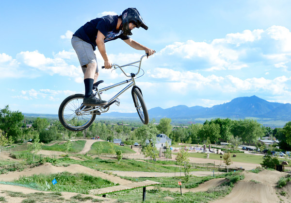 """Shawn Neer, of Boulder, catches some air while riding his bmx bike on Monday, May 21, at the Valmont Bike Park in Boulder. For more photos and video of the park go to  <a href=""""http://www.dailycamera.com"""">http://www.dailycamera.com</a><br /> Jeremy Papasso/ Boulder Daily Camera"""