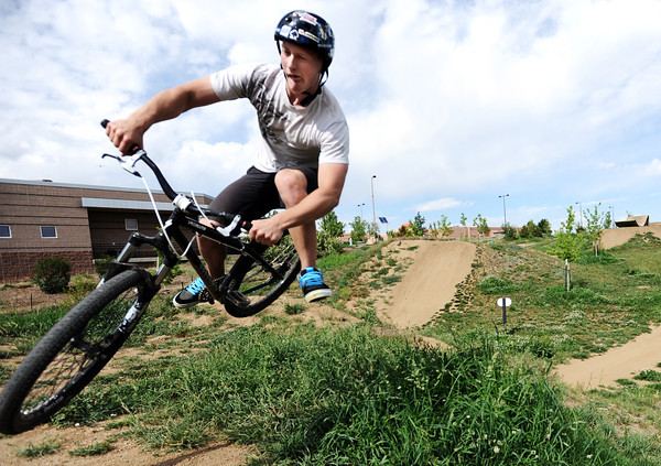 "Boston Cleek, of Boulder, catches some air on a table top jump on Monday, May 21, at the Valmont Bike Park in Boulder. For more photos and video of the park go to  <a href=""http://www.dailycamera.com"">http://www.dailycamera.com</a><br /> Jeremy Papasso/ Boulder Daily Camera"