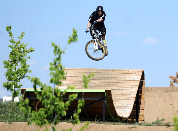 """Jay Fraser, of Boulder, hits one of the bike park features on Monday, May 21, at the Valmont Bike Park in Boulder. For more photos and video of the park go to  <a href=""""http://www.dailycamera.com"""">http://www.dailycamera.com</a><br /> Jeremy Papasso/ Boulder Daily Camera"""