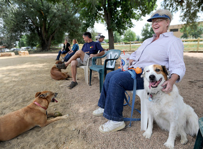 Rita Anderson, of Boulder, pets Jackie the dog while sitting in the shade on Friday, Aug. 24, at the Valmont Dog Park in Boulder. For a video about the new park go to www.dailycamera.com Jeremy Papasso/ Camera