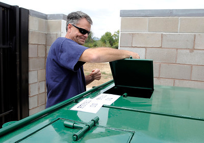 Dan Hall, of Nederland, closes the lid on the new dog poop compost bin on Friday, Aug. 24, at the Valmont Dog Park in Boulder. For a video about the new park go to www.dailycamera.com Jeremy Papasso/ Camera