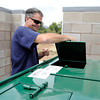 "Dan Hall, of Nederland, closes the lid on the new dog poop compost bin on Friday, Aug. 24, at the Valmont Dog Park in Boulder. For a video about the new park go to  <a href=""http://www.dailycamera.com"">http://www.dailycamera.com</a><br /> Jeremy Papasso/ Camera"