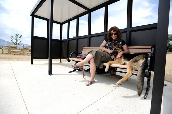 "Fran Blum sits on a bench with her dog Raffa on Friday, Aug. 24, at the Valmont Dog Park in Boulder. For a video about the new park go to  <a href=""http://www.dailycamera.com"">http://www.dailycamera.com</a><br /> Jeremy Papasso/ Camera"