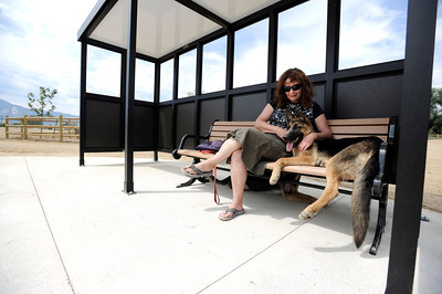 Fran Blum sits on a bench with her dog Raffa on Friday, Aug. 24, at the Valmont Dog Park in Boulder. For a video about the new park go to www.dailycamera.com Jeremy Papasso/ Camera