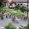 "The bike ride begins down Canyon Blvd.<br /> About 150 people rode bikes from the Central Park bandshell to the Valmont Coal Plant to protest its continued opening. The group  then planted sunflowers near the entrance on Saturday. For more a video and photos  of the protest, go to  <a href=""http://www.dailycamera.com"">http://www.dailycamera.com</a>.<br /> Cliff Grassmick / July 16, 2011"