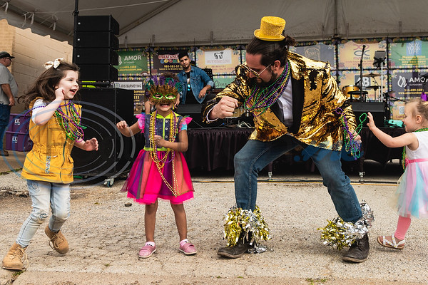 Levi Hollandsworth, sporting a gold sequin blazer, shares a dance with Copelyn Dennis, 4, (left) Khaliyah Makwangwala, 4, and Emma Dike, 2, as upbeat music plays over the loud speakers during Vandi Gras, a Mardi Gras celebration for Van Zandt County, Saturday, Feb. 29, 2020, in Van.