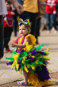Two-year-old Jacq Walthall is decked out in a yellow, green and purple tutu with matching shoes and a bow during Vandi Gras, a Mardi Gras celebration for Van Zandt County, Saturday, Feb. 29, 2020, in Van.