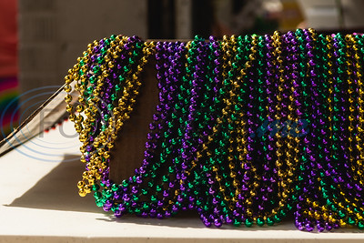 Gold, green and purple bead necklaces sit on display before being handed out to attendees during Vandi Gras, a Mardi Gras celebration for Van Zandt County, Saturday, Feb. 29, 2020, in Van.