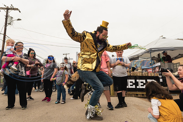 Levi Hollandsworth, sporting a gold sequin blazer and matching streamers around his ankles, (center) dances for a crowd to the music during Vandi Gras, a Mardi Gras celebration for Van Zandt County, Saturday, Feb. 29, 2020, in Van.