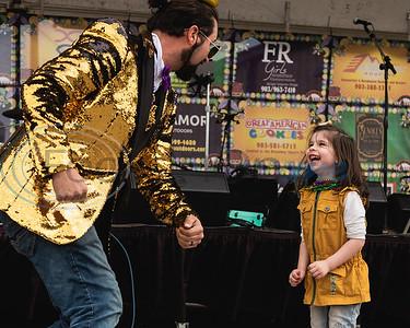 Levi Hollandsworth (left) and Copelyn Dennis, 4, dance to the music during Vandi Gras, a Mardi Gras celebration for Van Zandt County, Saturday, Feb. 29, 2020, in Van.