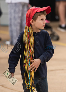 Eight-year-old Hunter Nusser sports a red hat with tens of bead necklaces during Vandi Gras, a Mardi Gras celebration for Van Zandt County, Saturday, Feb. 29, 2020, in Van.