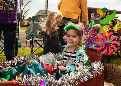 Four-year-old Harlow Buchanan in her decked out wagon after participating in the parade during Vandi Gras, a Mardi Gras celebration for Van Zandt County, Saturday, Feb. 29, 2020, in Van.