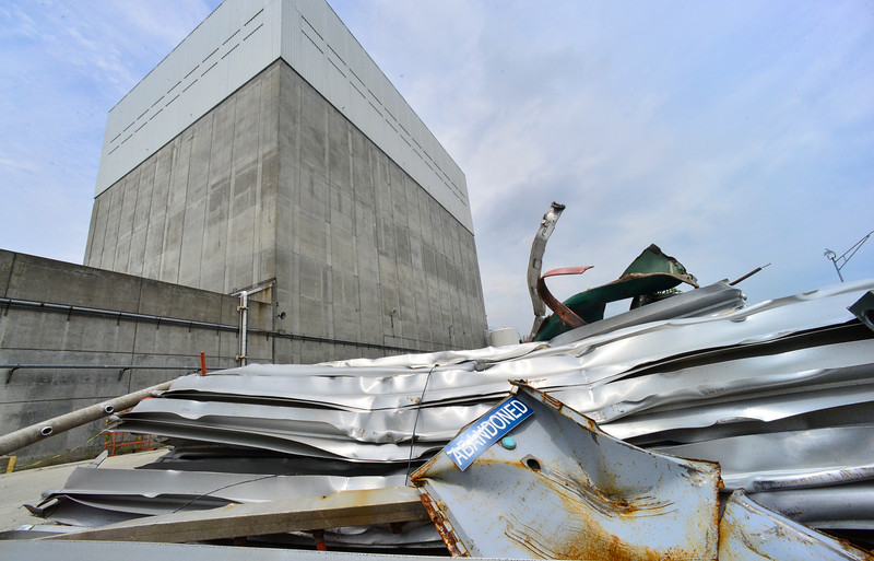 KRISTOPHER RADDER — BRATTLEBORO REFORMER<br /> An abandoned sign lays on top of a pile of scrap aluminum outside of the main reactor building of Vermont Yankee Nuclear Power Plant, in Vernon, Vt., on Thursday, July 11, 2019.