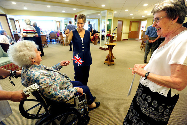 VETERANS<br /> Sheilah Bowles, left, who served in the Royal Navy, is cheered on by staff member Kathryn Aronson, center, and fellow resident Betty Fischer, right, at Frasier Meadows retirement community during a ceremony honoring its 72 military veterans on Friday morning.<br /> <br /> Photo by Marty Caivano/July 1, 2011
