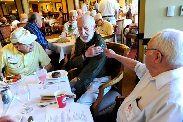 "VETERANS<br /> Clyde Richey, center, who served in the Army in World War II, talks about his uniform with Ed Putzier, right, who served in the Navy, and Ray Joyce, left, who was in the Army Air Force. The men were socializing at Frasier Meadows retirement community during a ceremony honoring its 72 military veterans on Friday morning. For a video of the event, see  <a href=""http://www.dailycamera.com"">http://www.dailycamera.com</a>.<br /> <br /> Photo by Marty Caivano/July 1, 2011"