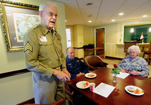 VETERANS<br /> Brad Beeler, left, who served in the Army during World War II, chats with friends at Frasier Meadows retirement community during a ceremony honoring its 72 military veterans on Friday morning. At center is Chuck Warden, who served in the Air Force, and at right is Sheilah Bowles, who served in Great Britain's Royal Navy.<br /> <br /> Photo by Marty Caivano/July 1, 2011