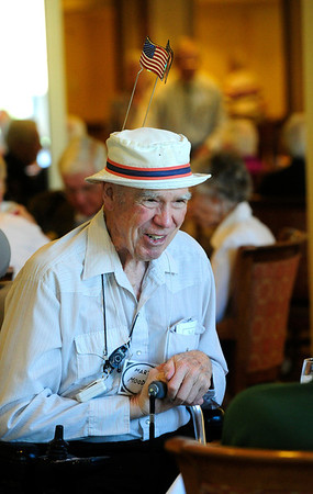 VETERANS<br /> Martin Moody, who served in the Navy in World War II, wears a flag hat at Frasier Meadows retirement community during a ceremony honoring its 72 military veterans on Friday morning.<br /> <br /> Photo by Marty Caivano/July 1, 2011