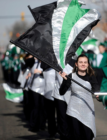 Erika Volino, with the Niwot High School Color Guard, marches during the Veteran's Day Parade on Main Street in Longmont, Colorado November 11, 2009. CAMERA/Mark Leffingwell