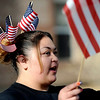 With flags in her hair, Linda Orozco waves to paraders during the Veteran's Day Parade on Main Street in Longmont, Colorado November 11, 2009. CAMERA/Mark Leffingwell