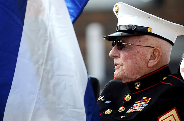 USMC Staff Sergeant Bob Conner holds the Colorado Flags during the Veteran's Day Parade on Main Street in Longmont, Colorado November 11, 2009. CAMERA/Mark Leffingwell