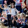 Cayla Mollen (left), 6, and Elizabeth Hupka (right), 6, yell and wave during the Veteran's Day Parade on Main Street in Longmont, Colorado November 11, 2009. CAMERA/Mark Leffingwell