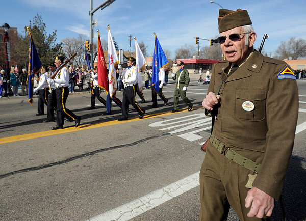 Dick Kounovsky calls cadence for the American Legion Honor Guard during the Veteran's Day Parade on Main Street in Longmont, Colorado November 11, 2009. CAMERA/Mark Leffingwell