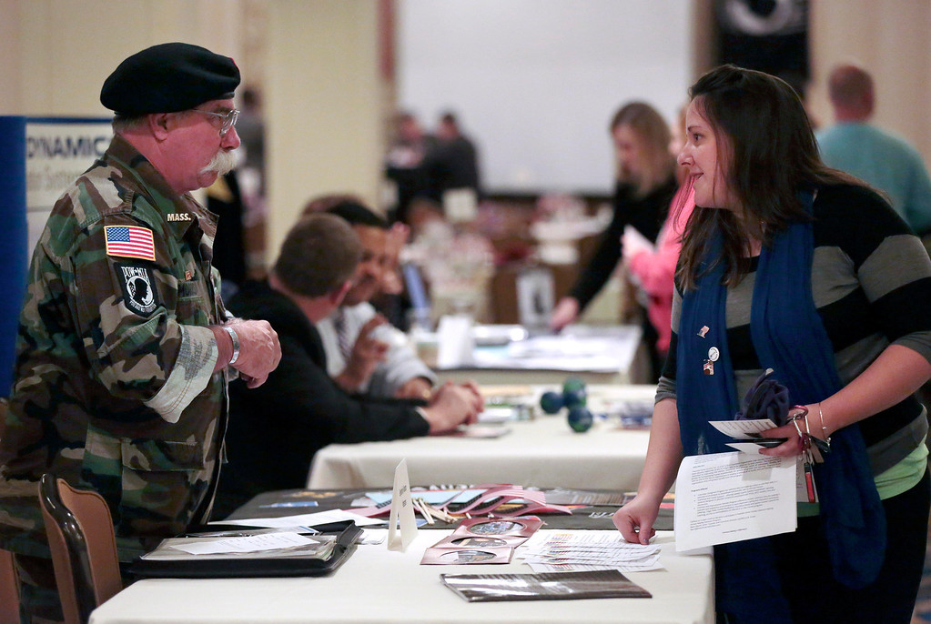 . Veterans Henry Morris and Lisa Catullo chat at the Vietnam Veterans Berkshire Chapter 65 table at the Veteran\'s Expo at the Crowne Plaza hotel in Pittsfield. Friday, November 15, 2013. (Stephanie Zollshan | Berkshire Eagle Staff)
